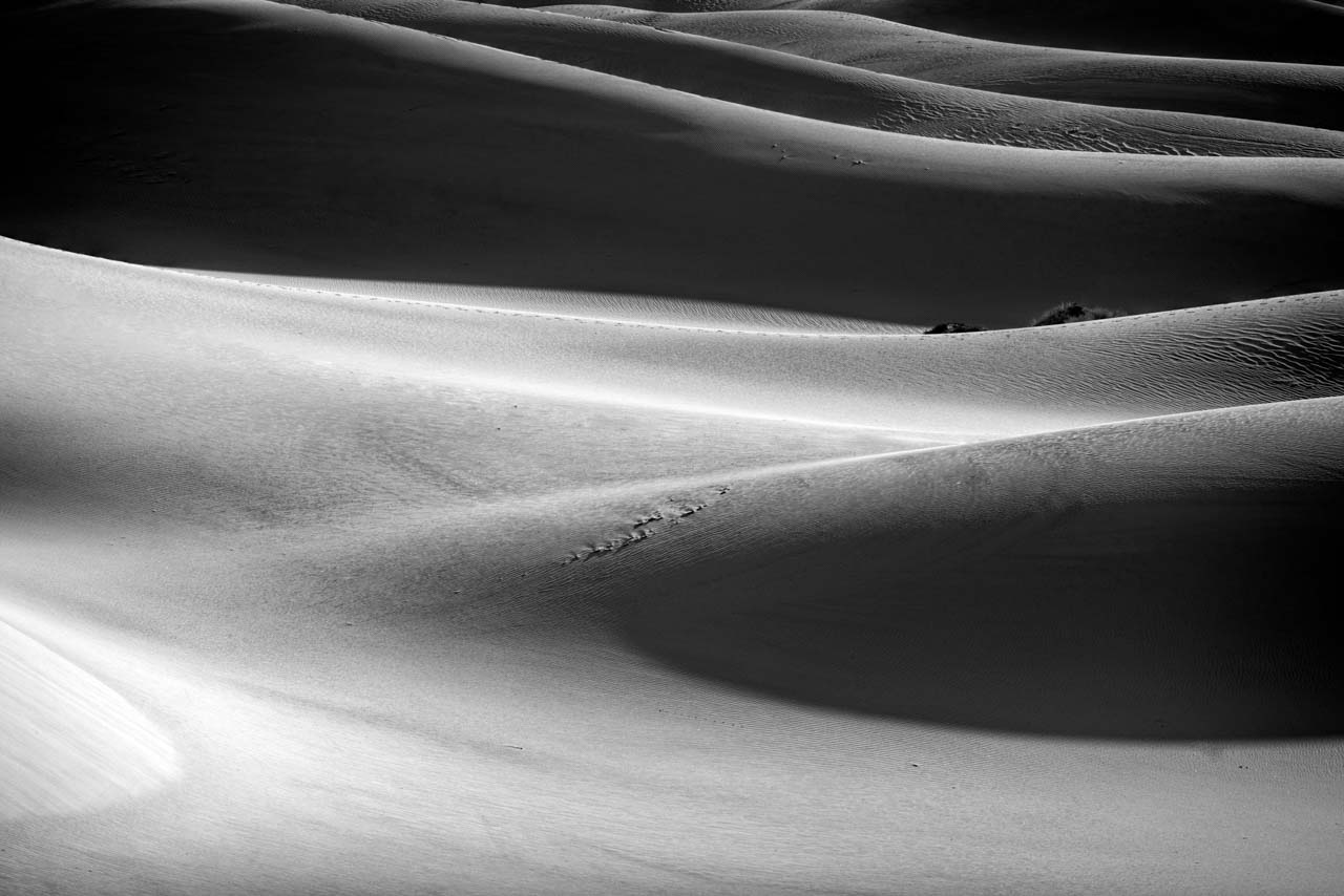 This photograph of sand dunes in California's Death Valley is an example of rhythm in a photograph.