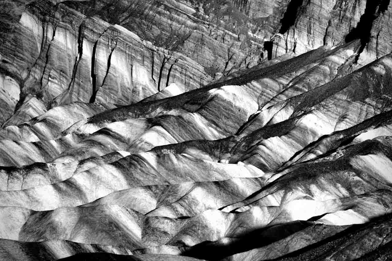 Black and white photograph of Zabriskie Point in the Valley of Death to illustrate the photographic rhythm.