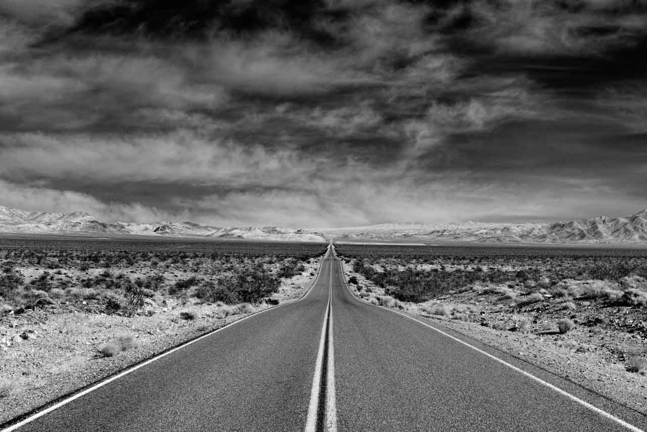 An example of perspective: a road in California in black and white. The depth effect is striking.