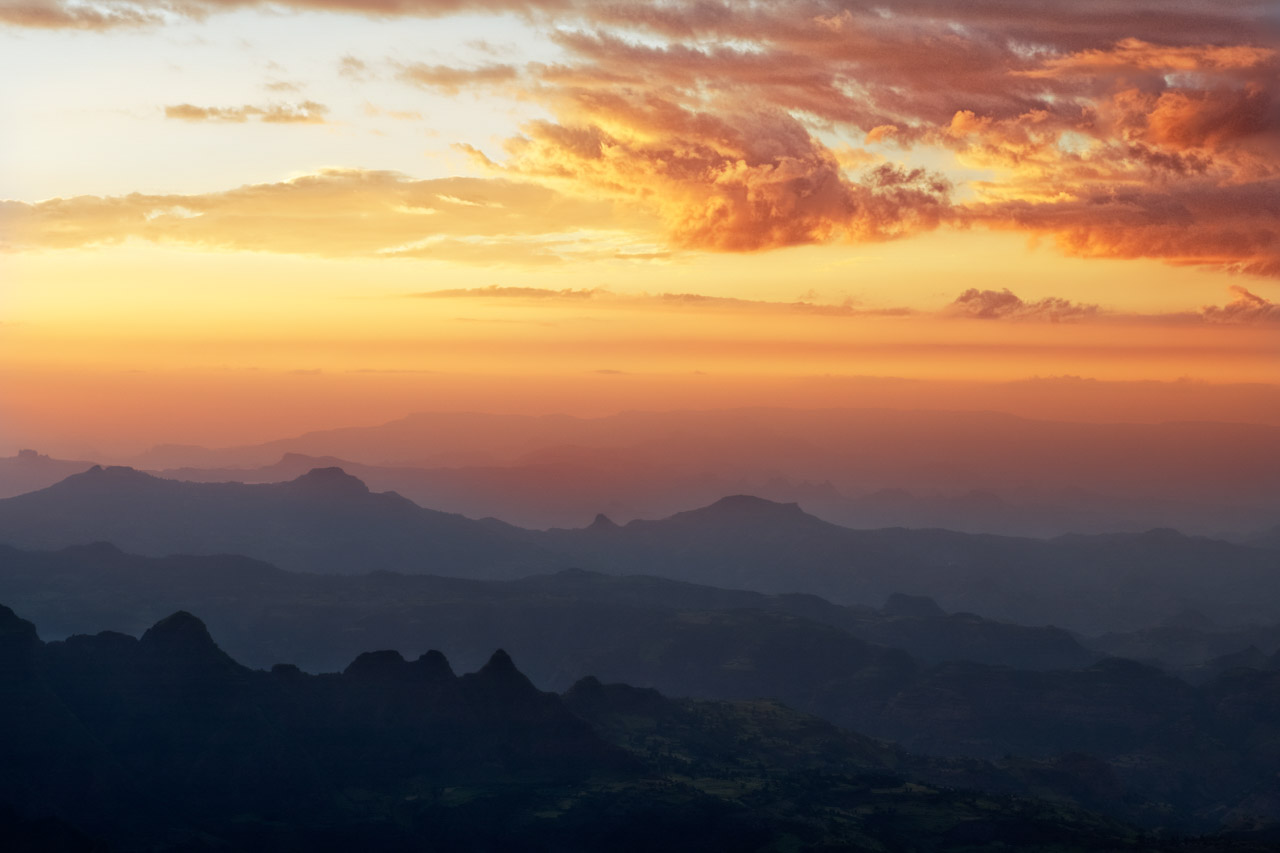 Sunrise over the Simien Mountains in Ethiopia. Photograph in color by Amar Guillen, artist photographer.