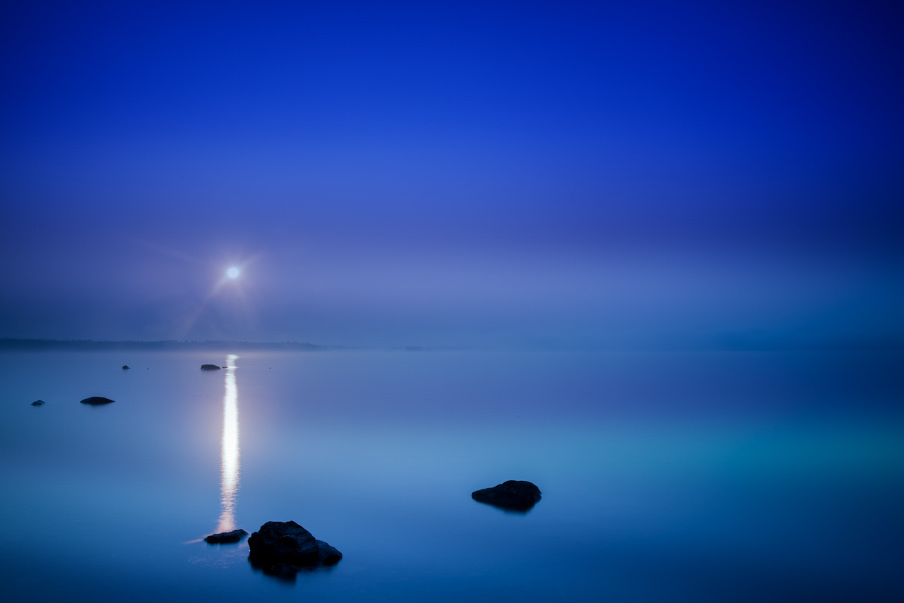 Blue hour in the morning on Yellowstone lake. Photograph by Amar Guillen, photographer artist.