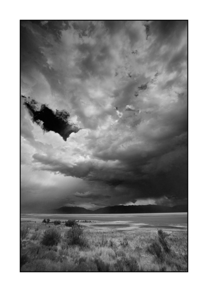 Landscape in black and white of Antelope Island in Utah under a storm