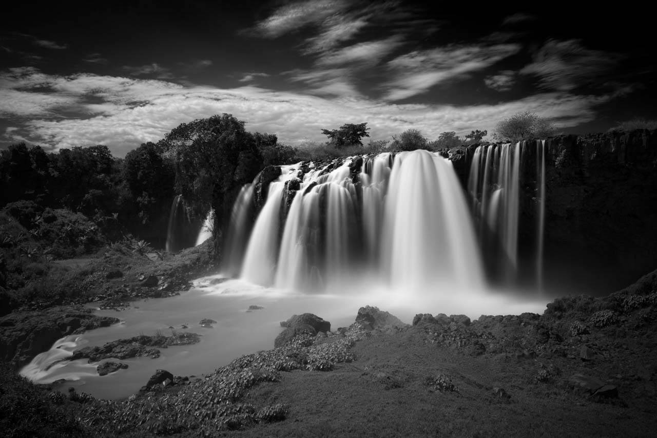 Blue Nile Falls near Tana in Ethiopia. Photograph in black and white by Amar Guillen, photographer artist.