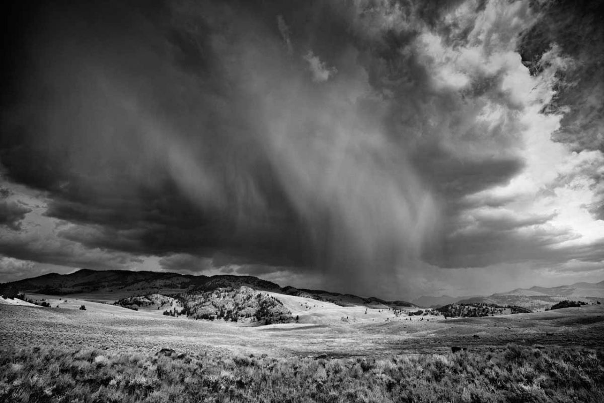Photo in black and white of a storm over Yellowstone.